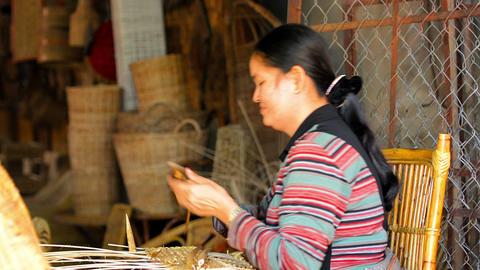 SIEM REAP. CAMBODIA - CIRCA DEC 2013: Local artisan preparing materials and weav Footage