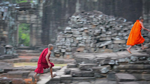 SIEM REAP. CAMBODIA - CIRCA DEC 2013: Two boys in traditional monk robes running Footage
