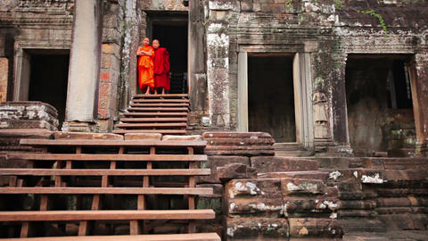 PHNOM PENH. CAMBODIA - CIRCA DEC 2013: Two Cambodian children in monks robes sta Footage