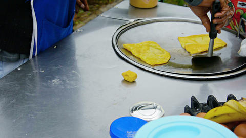 CHIANG MAI. THAILAND - CIRCA DEC 2013: Local Street Food Vendor Preparing Omelet stock footage
