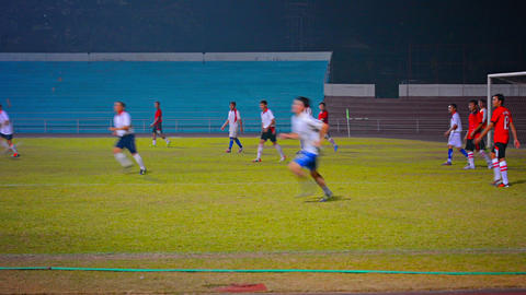 VIENTIANE. LAOS - CIRCA DEC 2013: Ongoing Evening Football Game On A Lighted Fie stock footage