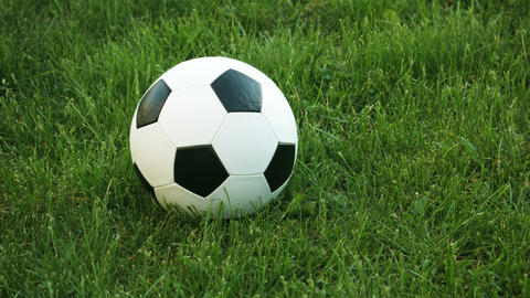 Video UltraHD - Closeup. slow tracking shot of a football. with its geometric pa Footage