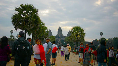 ANGKOR. CAMBODIA - CIRCA DEC 2013: Crowd of tourists standing and strolling on t Footage