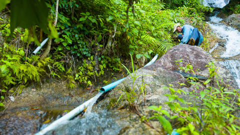 PHUKET. THAILAND - CIRCA DEC 2014: Local laborer repairing water system pipes be Footage