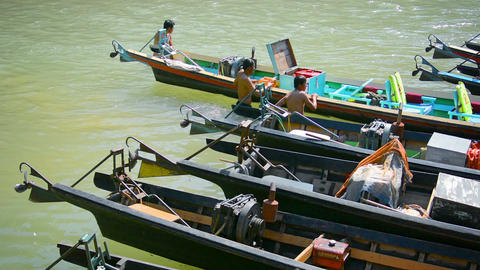 INLE LAKE. MYANMAR - CIRCA JAN 2014: Local busy repairing boats. Boats used for Footage