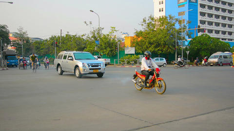 VIENTIANE. LAOS - CIRCA DEC 2013: Traffic at a typical intersection in Vientiane Footage