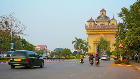 VIENTIANE. LAOS - CIRCA DEC 2013: Ornate memorial roadway arch over an important Footage