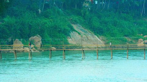 Villagers Crossing a Bamboo Bridge near Luang Prabang. Laos Footage