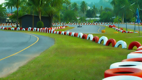 PHUKET. THAILAND - CIRCA FEB 2015: Tourists racing around a sharp bend in the pa Footage