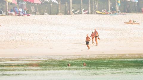 KAMALA. PHUKET. THAILAND - CIRCA DEC 2014: Foreign tourists enjoying a sunny day Footage