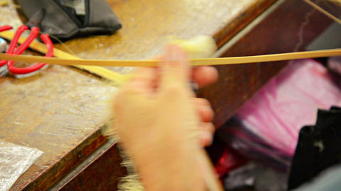 Local Artists Splits and Shaves Strips of Dried Bamboo Footage