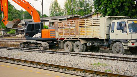 LOPBURI. THAILAND - CIRCA NOV 2013: Heavy equipment digging into rail bed on a r Footage