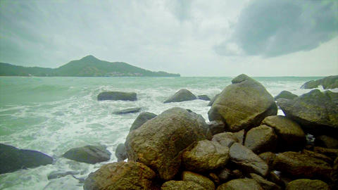 Large waves and rocks. Storm on the ocean coast Footage