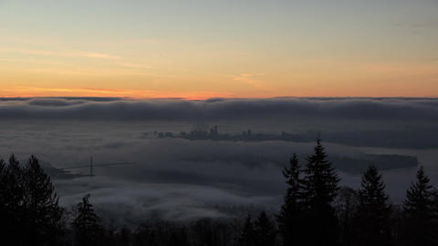 Sunrise with fog covering Vancouver Footage