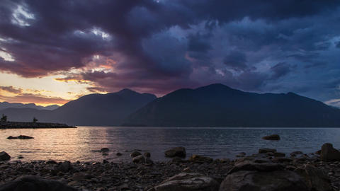 Time lapse of vibrant cloudy sunset Footage