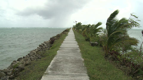 Tropical Storm Winds Blow Across Ocean Walkway stock footage