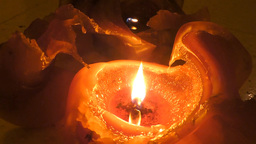 Two orange candle burning - seamless looping Footage