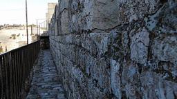 Walk along outside of the Jerusalem old city walls Footage