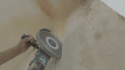 Angle grinder cut a wall with lots of dust Footage