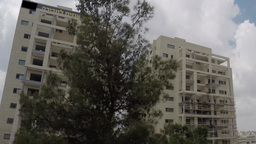 Fast timelapse Dismounting a scaffold of a big building in Jerusalem Footage