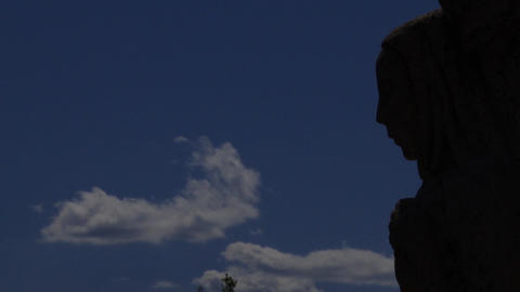 Statue Blowing Clouds stock footage