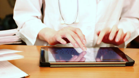 Doctor Working On Tablet Computer Footage