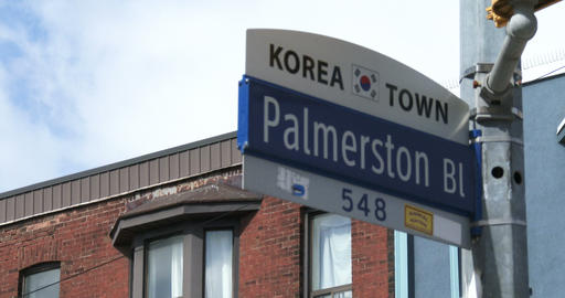 Street sign of Palmerston boulevard in Korea town neighbourhood in Toronto Footage
