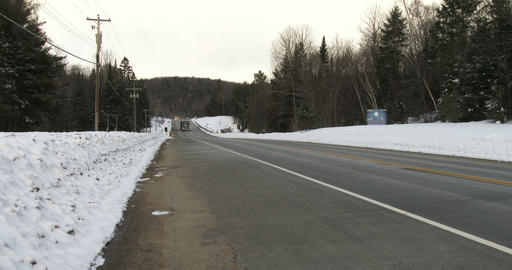 Truck driving on highway 60 in Algonquin Provincial Park Footage