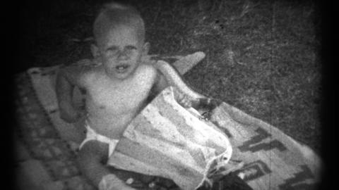 (1940's 8mm Vintage) Baby Playing Outside - 2 Clips Footage