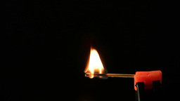 Matchstick igniting against black background 04 Archivo
