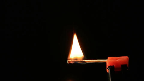 Matchstick igniting against black background 06 Archivo
