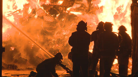 firemen at a large fire Stock Video Footage
