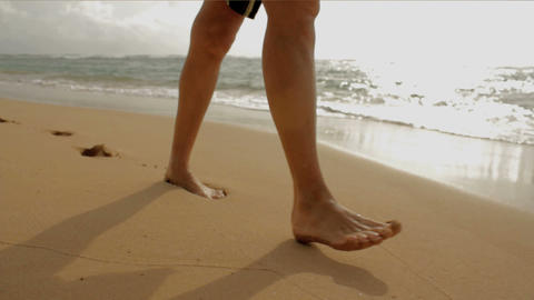 Walking on beach and water 2 Stock Video Footage