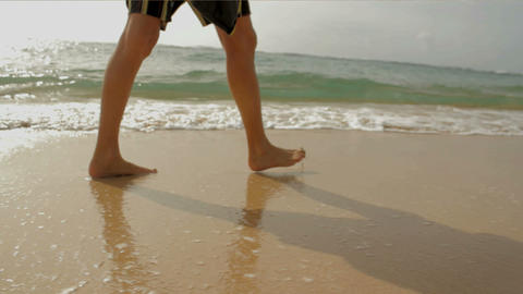Walking on beach and water Stock Video Footage
