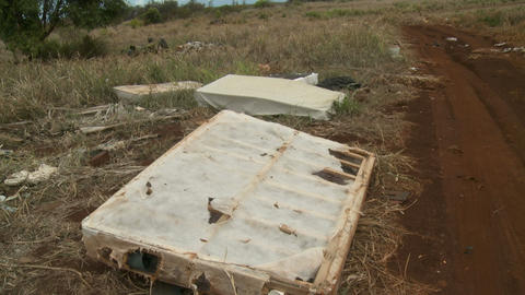 dirty junk mattress on a country road Stock Video Footage