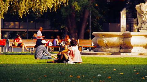 Young People in a Park stylized retro filmlook Stock Video Footage