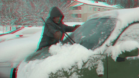 Stereoscopic 3D time-lapse of cleaning car window after snow storm 1 combo Footage