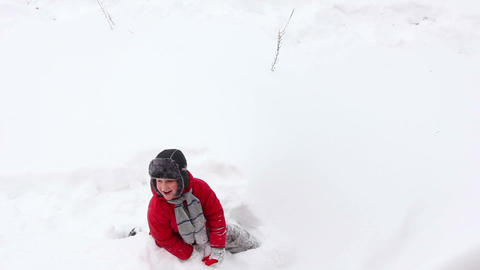 Boy play in snow 1 Stock Video Footage