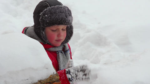 Boy play in snow 3 Stock Video Footage