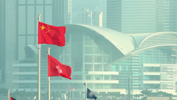 Flags of China and Hong Kong SAR waving in the wind Footage