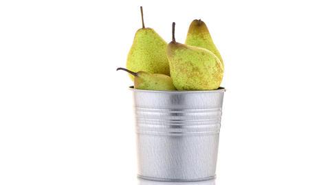 Ripe pears on metal buket Footage