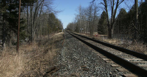 Long train track in the woods in Canada Footage
