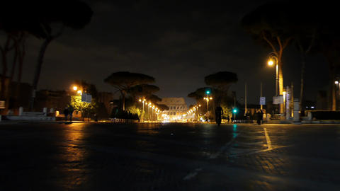 Via dei Fori Imperiale view of the Coliseum. Night Rome, Italy Footage