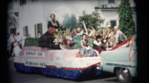 (1950's 8mm Vintage) Old Time Main Street Parade stock footage