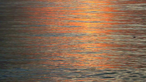 Reflection Of Heat Waves From The Water Surface During Sunset Time stock footage