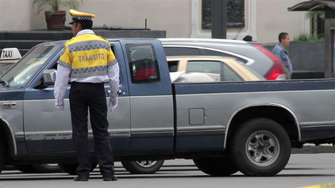 Mexico City, Mexico-CIRCA June, 2014: Full shot Police directing traffic Footage