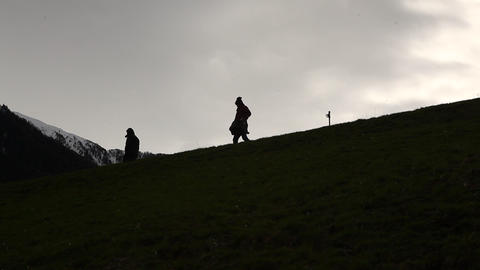 Silhouette of people on the hill Stock Video Footage