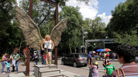 Mexico City, Mexico-CIRCA July,2014: Tourists taking pictures in wings structure Footage