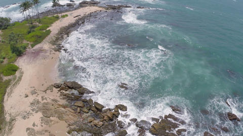 flying over sea waves and stones Footage
