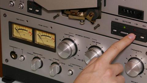 hand man operates reel tape recorder - 4k Footage